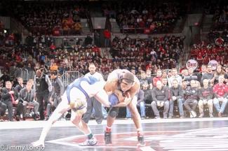 Myles Martin works on a leg against Bo Nickel of Penn St