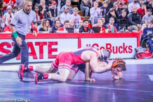 Nathan Tomasello works for position against Zane Richards of Illinois