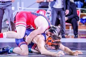 Nathan Tomasello works on top against Zane Richards of Illinois